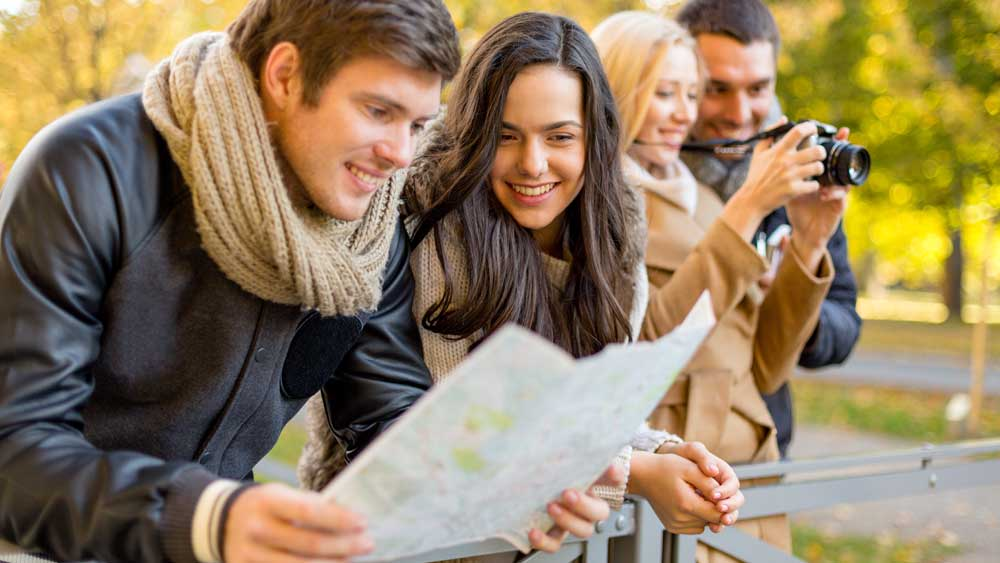 1.-Group-of-tourists-map-in-city-park-1