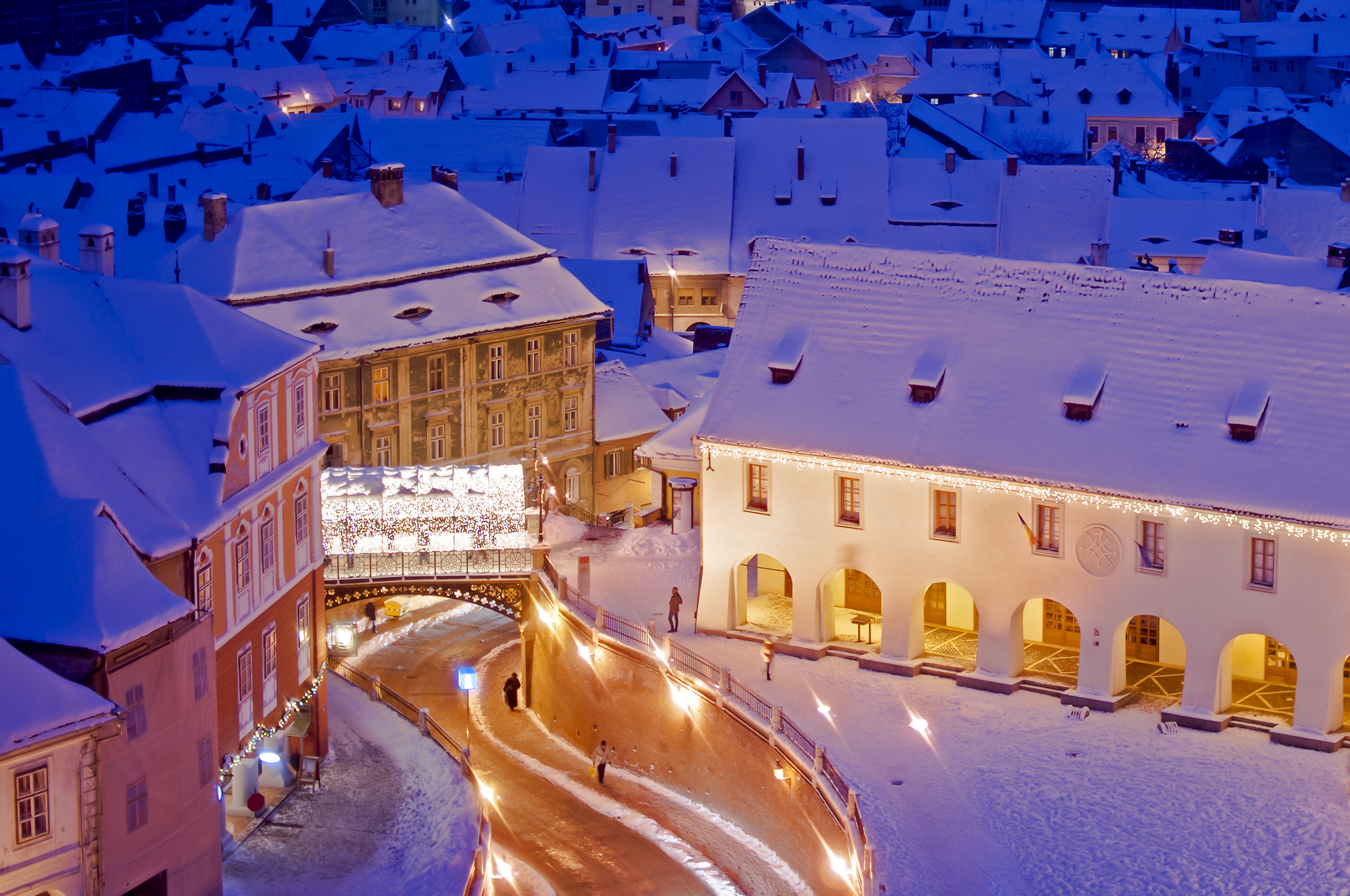 Sibiu, Romania, old town landmark (Liars bridge) in winter with Christmas lights decoration